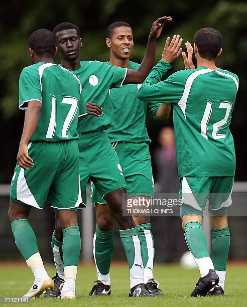 Players of the national football team of Saudi Arabia Mohammed Al Anbar Mohammed Massad Naif AlQadi and Abdulaziz AlKhathran celebrate after scoring...