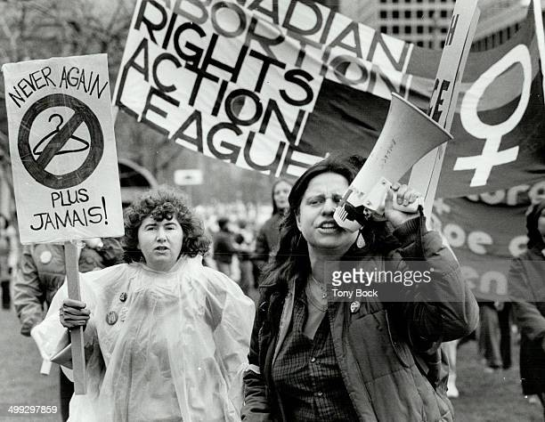 Bad old days A prochoice marcher's sign opposes a return to the days of illegal often amateur abortions symbolized by the coathanger with which they...