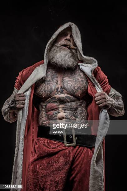 bad santa claus aka father christmas - dirty santa stock pictures, royalty-free photos & images