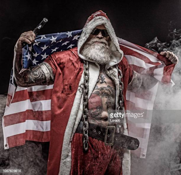 bad santa claus - stars and stripes stock pictures, royalty-free photos & images