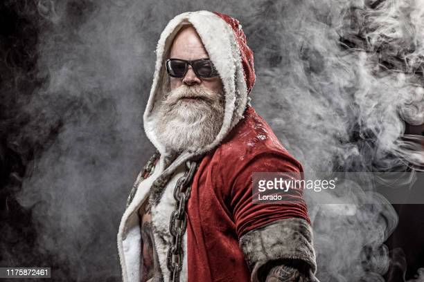 bad santa claus - dirty santa stock pictures, royalty-free photos & images