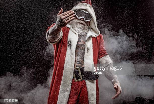 bad santa claus - bad santa stock-fotos und bilder