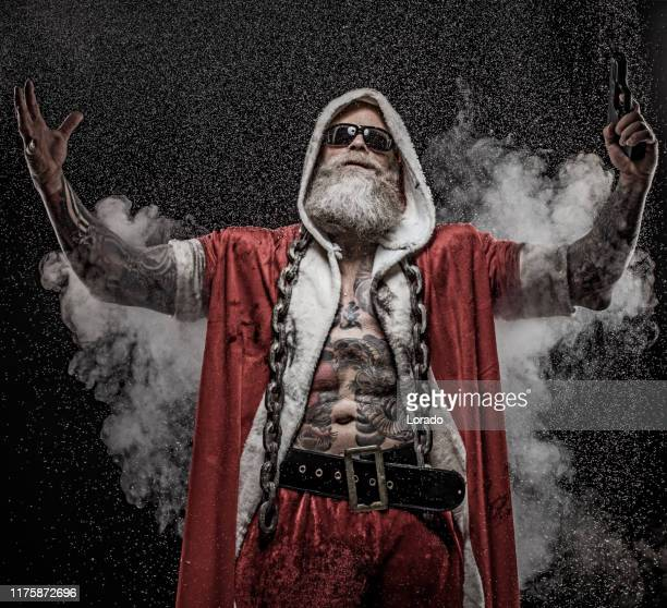 bad santa claus with gun - dirty santa stock pictures, royalty-free photos & images