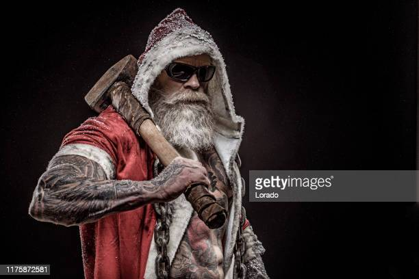 bad santa claus with hammer - dirty santa stock pictures, royalty-free photos & images