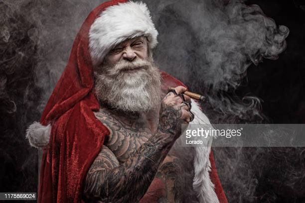 bad santa claus with knives - dirty santa stock pictures, royalty-free photos & images