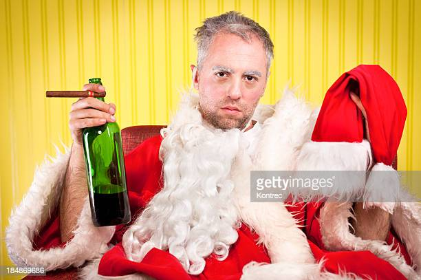 bad santa in holiday depression - naughty santa stock photos and pictures