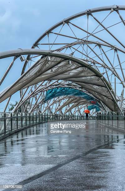 bad weather at the helix bridge, singapore - singapore stock pictures, royalty-free photos & images