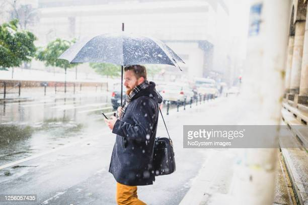 bad weather commuter - torrential rain stock pictures, royalty-free photos & images