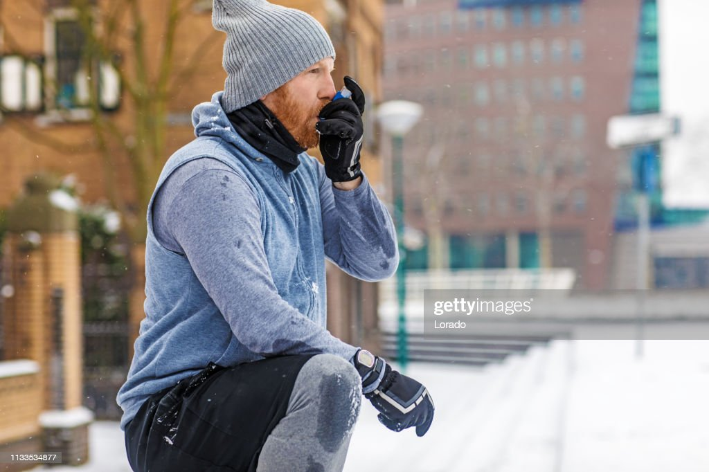 Bad weather fitness training for asthmatic man : Stock Photo