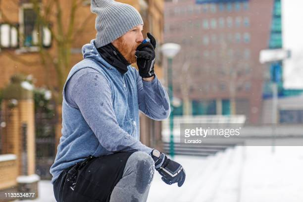 bad weather fitness training for asthmatic man - asthma stock pictures, royalty-free photos & images