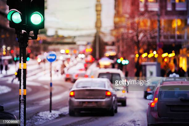 bad weather, snow and rain in the evening traffic - traffic stock pictures, royalty-free photos & images