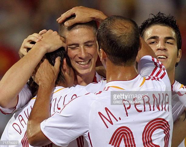 Spain's Fernando Torre celebrates after scoring against Liechtenstein with teammates, Cesc , Pernia and David Villa during a Euro2008 qualifying...