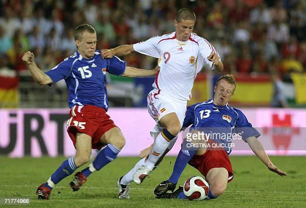 Spain's Fernando Torres jumps dribbles past Liechtenstein's Maierhofer and Martin Buchel during a Euro2008 qualifying match at the Nuevo Vivero...