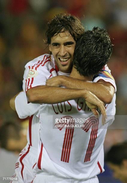 Spain's Luis Garcia celebrates with Raul after scoring against Liechtenstein during a Euro2008 qualifying match at the Nuevo Vivero stadium in...