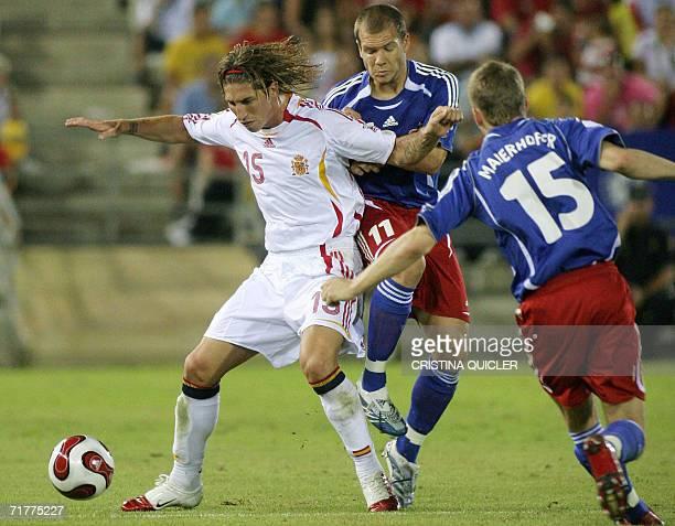 Spain's Sergio Ramos holds off Liechtenstein's Martin Buchel and Maierhofer during a Euro2008 qualifying match at the Nuevo Vivero stadium in...