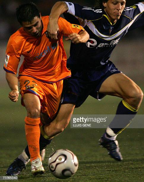 Barcelona's Argentinian Javier Saviola vies with CF Badalona's Pons during their King's Cup football match at Camp del Centenari stadium in Badalona...