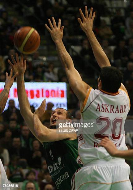 DKV Joventut's Lubos Barton vies with Lottomatica's Ognjen Askrabic during the EuroLeague basketball match played at Pabellon Municipal de Deportes...