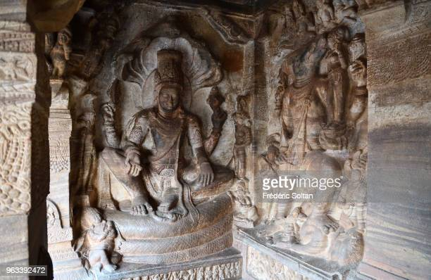 Badami Cave Temples The Badami Cave Temples are composed of four rockcut caves built during the 6th century Sculpture of Vishnu resting on Shesha on...