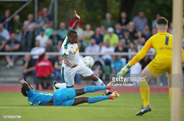 Badara Njie of BSC Hastedt and Alassane Plea of Borussia Moenchengladbach battle for the ball during the DFB Cup first round match between BSC...
