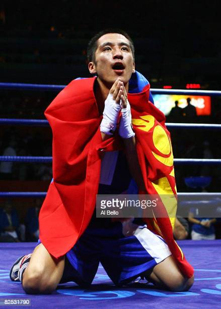 BadarUugan Enkhbat of Mongolia celebrates after defeating Yankiel Leon Alarcon of Cuba during the Men's Bantam Final Bout held at the Workers' Indoor...