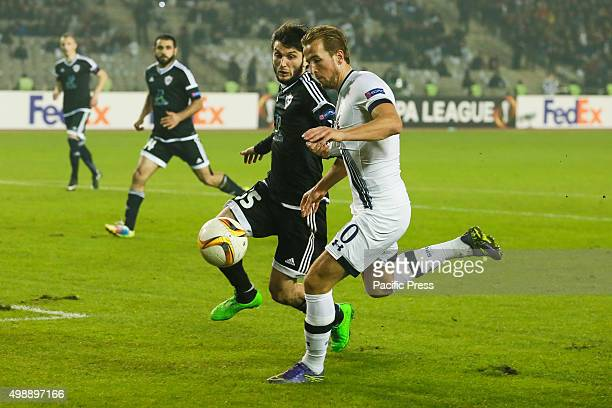 Badavi Guseynov of Qarabag FK is challenged by Harry Kane of Tottenham Hotspur FC during the UEFA Europe League match between Qarabag FK and...
