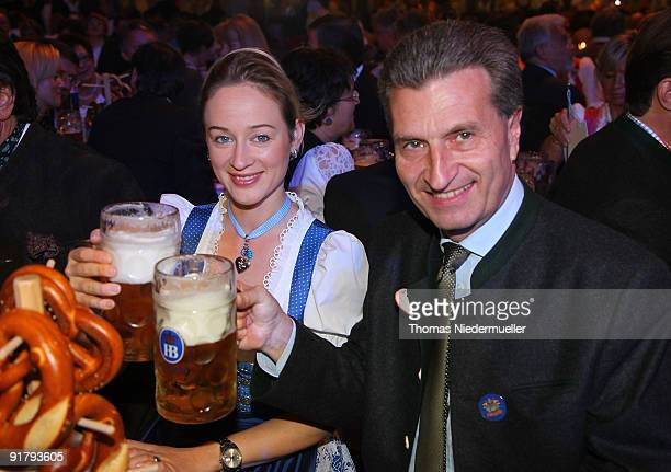 Baden Wuerttemberg governor Guenther Oettinger and his girlfriend Friederike Beyer cheer during the celebration of the 60th birthday of Roland Mack...