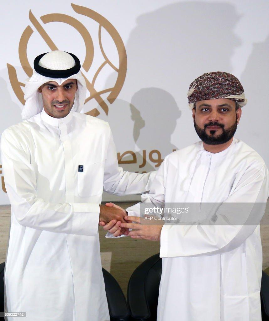 Bader Al-Kharafi , vice-chairman and Group CEO of Zain Group, shakes