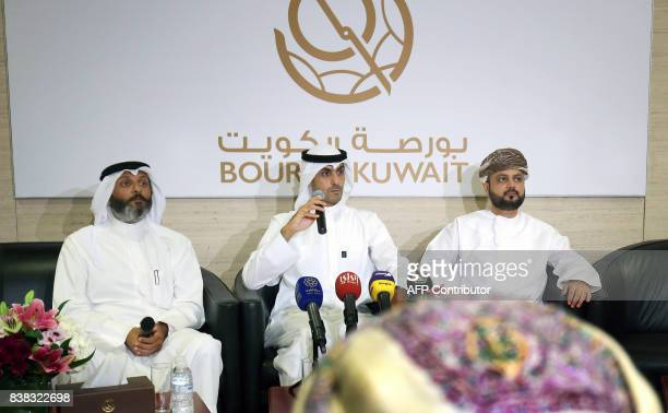 Bader AlKharafi vicechairman and Group CEO of Zain Group sits between Omantel CEO Talal Said alMamari and the CEO of Boursa Kuwait Khaled AlKhaled as...