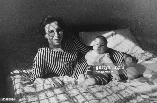 Bader Turner, wife of Jesse Turner, kidnapped by Islamic Jihad, seen on bed w. Their baby daughter, Joanne.