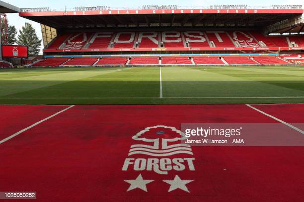 Badge between the dugouts at the City Ground home stadium of Nottingham Forest during the Carabao Cup Second Round match between Nottingham Forest...