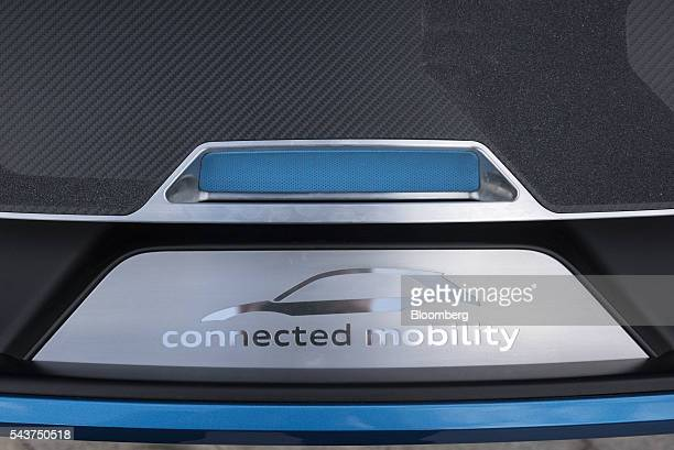 A badge displaying the connected mobility logo is displayed on the front of a prototype of Audi AG's connected mobility vehicle at the company's...