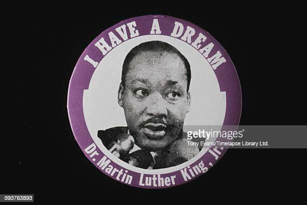 A badge featuring American civil rights activist Martin Luther King Jr and the quote from his famous speech 'I Have a Dream' circa 1963