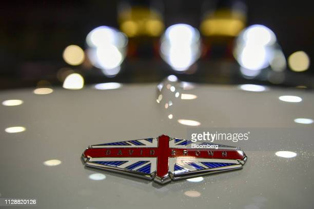 A badge featuring the Union Flag also known as a Union Jack sits on a remastered Mini automobile on the David Brown Automotive stand on day two of...