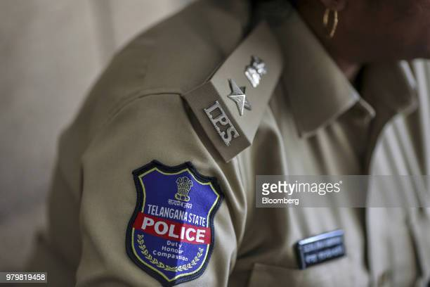A badge is displayed on the uniform of Rema Rajeshwari superintendent of police for the Indian Police Service as she speaks during an interview in...