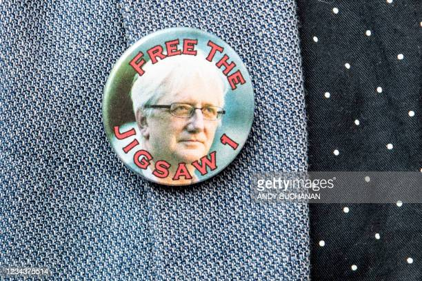 Badge is pictured, worn by a supporter of Britain's former ambassador to Uzbekistan, Craig Murray outside St Leonard's Police Station in Edinburgh on...