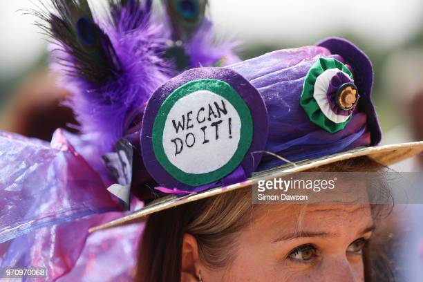 A badge is seen on the hat of a women as she takes part in mass participation artwork 'Processions' to celebrate one hundred years of votes for women...