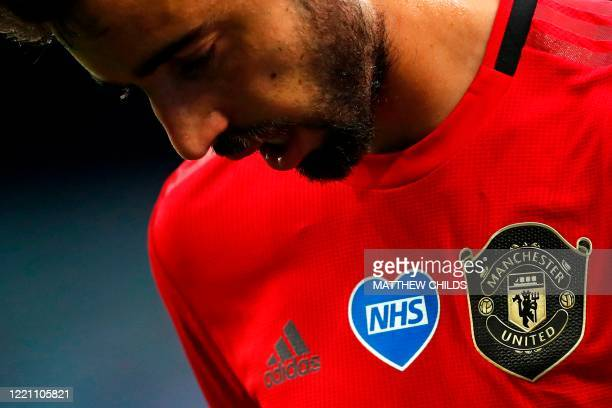 Badge is seen on the shirt of Manchester United's Portuguese midfielder Bruno Fernandes during the English Premier League football match between...