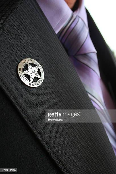 badge - metallic suit stock photos and pictures