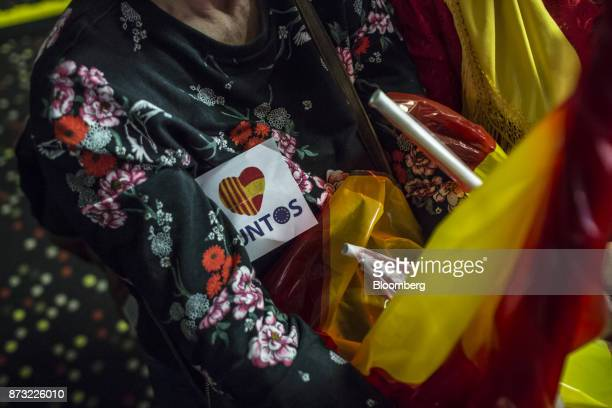 A badge reading 'Juntos' or 'Together' sits on the blouse of an attendee ahead of a speech by Mariano Rajoy Spain's prime minister and leader of the...