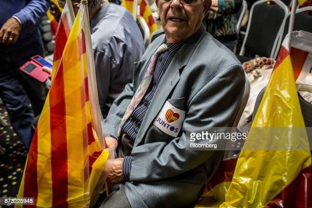 A badge reading 'Juntos' or 'Together' sits on the pocket of an attendee ahead of a speech by Mariano Rajoy Spain's prime minister and leader of the...