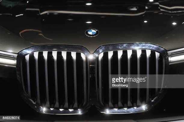 A badge sits above the grille of a BMW X7 sports utility vehicle manufactured by Bayerische Motoren Werke AG during the second media preview day of...