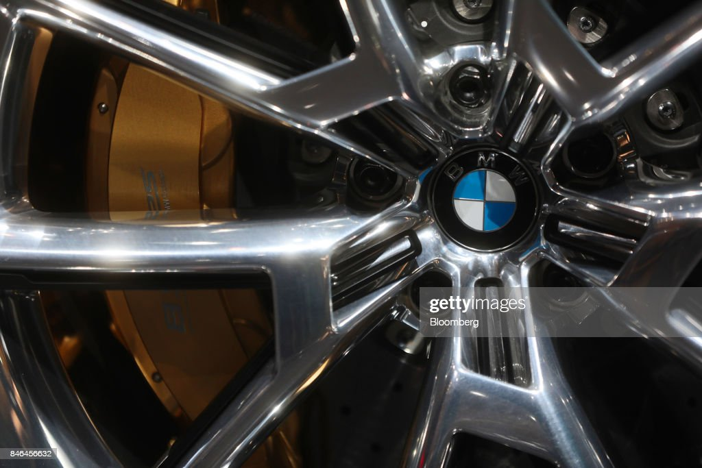 A badge sits beside the brake caliper on the wheel hub of a BMW 8 Series electric concept automobile, manufactured by Bayerische Motoren Werke AG (BMW), during the second media preview day of the IAA Frankfurt Motor Show in Frankfurt, Germany, on Wednesday, Sept. 13, 2017. The 67th IAA opens to the public on Sept. 14 and features must-have vehicles and motoring technology from over 1,000 exhibitors in a space equivalent to 33 soccer fields. Photographer: Simon Dawson/Bloomberg via Getty Images