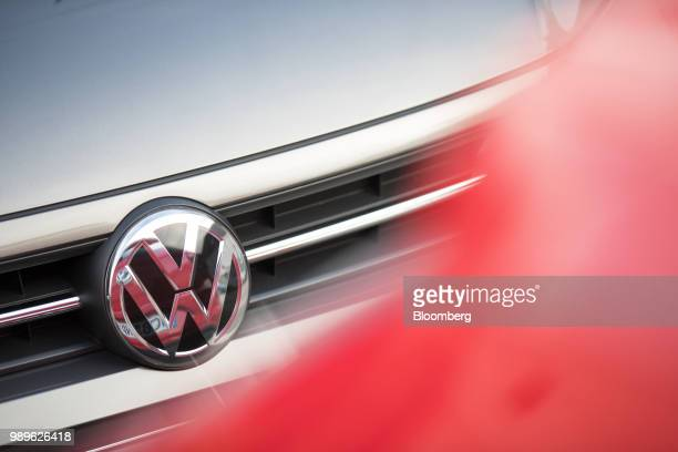 A badge sits on a Volkswagen AG Polo TGI compressed natural gas fueled automobile during the VW compressed natural gas Mobility Day in Essen Germany...