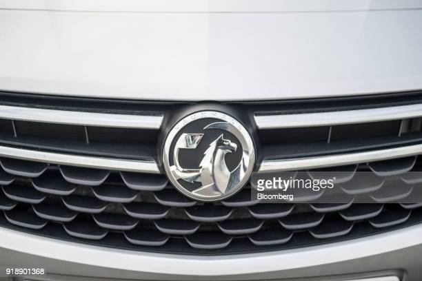 A badge sits on an automobile manufactured by Vauxhall Motors Ltd owned by PSA Group in their factory parking lot in Ellesmere Port UK on Monday Feb...