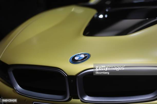 A badge sits on the hood of a BMW i8 electric automobile manufactured by Bayerische Motoren Werke AG during the second media preview day of the IAA...