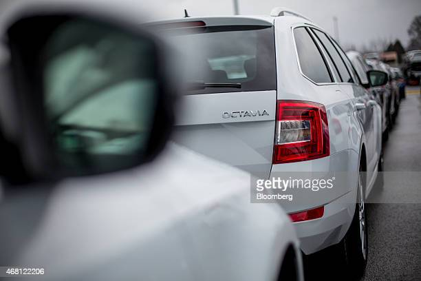 A badge sits on the trunk of an Octavia automobile in a parking lot ahead of distribution at Volkswagen AG's Skoda Auto AS manufacturing plant in...