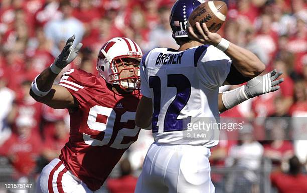 Badger defensive lineman Jason Chapman rushes Northwestern quarterback Andrew Brewer at Camp Randall Stadium in Madison Wisconsin October 7 2006