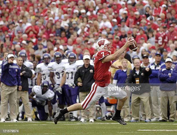 Badger quarterback John Stocco heads toward the endzone during the game between the Wisconsin Badgers and the Western Illinois Leathernecks at Camp...