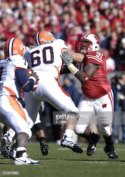Badgers lineman Jason Chapman tries to get to Illini quarterback Isiah Williams during the game between the Wisconsin Badgers and the Illinois...