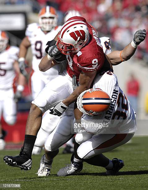 Badgers tight end Travis Beckum is tackled during the game between the Wisconsin Badgers and the Illinois Fighting Illini at Camp Randall Stadium in...